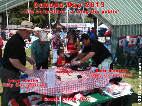 Councillors Smith and Kendel serve cake to the public during the 2013 Canada Day Celebration